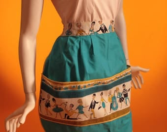 Vintage 1950's Novelty Print Cotton Apron in Blue and Yellow Featuring Musicians and Dancers