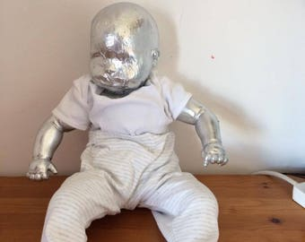 Silver Faceless Doll