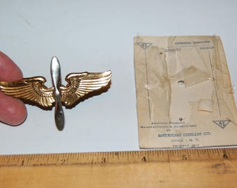 WWII,  U.S. Army Air Corps Cadet 3 in. Winged Propeller Hat Emblem (unissued) by American Emblem Co. Utica, NY