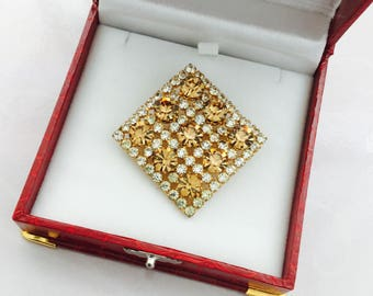 1960's rhinestone brooch and matching clip earrings.