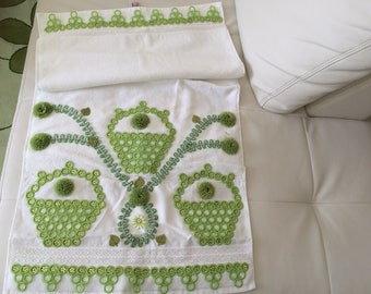Towel decorated with crochet lace and rhinestones