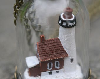 Beautiful miniature lighthouse in tiny bell jar pendant