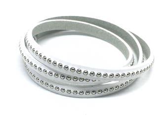 White studded leather bracelet. Wrap around.
