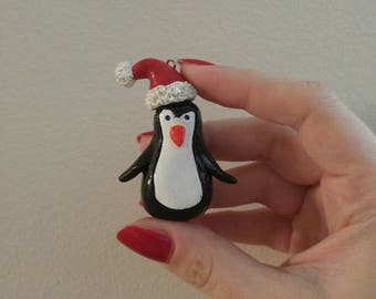 Penguin Christmas ornament with santa hat - handmade polymer clay penguin decor