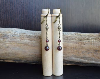 Long earrings with Garnet beads.