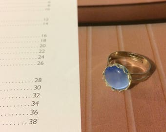 Small bright blue cabochon ring