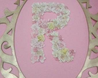 Finely decorated floral name initial letter with handmade paper roses