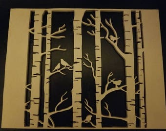 Scroll saw cut out of birch trees with birds