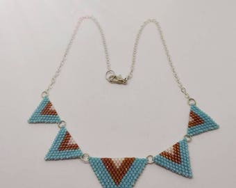 Weaving in Miyuki beads and metal chain necklace