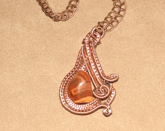 339 V complex darkened copper swirl agate ampersand