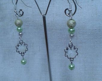 Green beads and silver charm earrings