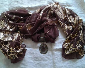Brown and gold scarf and his jewelry bronze