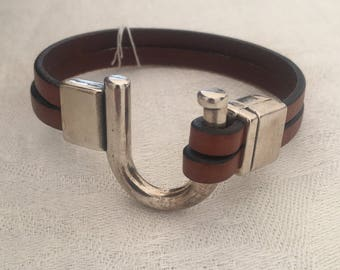 Brown leather with silver plate U shaped clasp