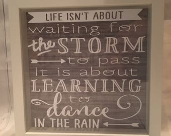 Life isnt about waiting for the storm to pass, it is about learning to dance in the rain box frame.