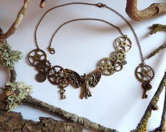 Bronze steampunk Necklace: arrow, pendulum, gears, keys.