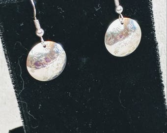 Round sterling silver stamped and domed earrings.