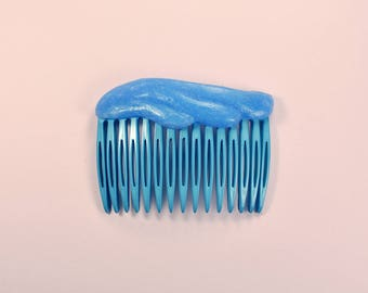 Blue comb with soft silicone decoration
