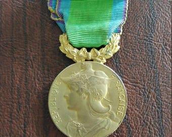 Vintage Gilt Metal French Art Medal of The League for Public Good (Medaille du Bien Public), Marianne in Winged Helmet