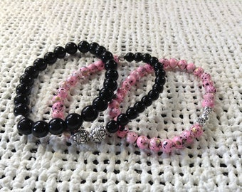 Pink and black bracelet trio