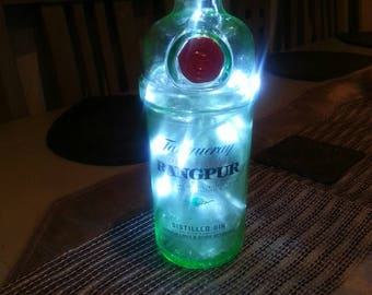 Tanqueray Rangpur Gin lights in a bottle.