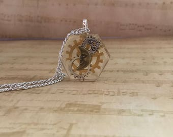 SteampunkPendant , hexagon resin , gear wheel and moon charms