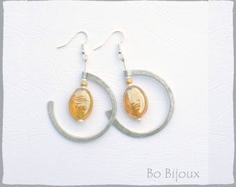 yellow glass pearl and metal earrings