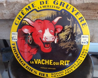 Antique French enamel plaque accounting requires time (the laughing cow)