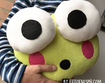 Green frog-shaped stuffed cushion with bulging eyes