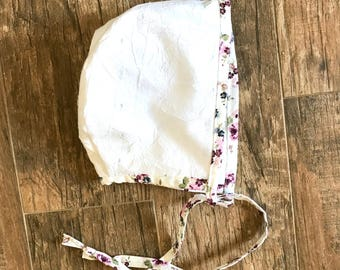 White and floral bonnet