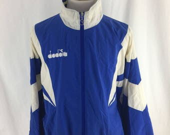 Vintage 90s Diadora Blue and white Windbreaker Cut and Sewn Size XL