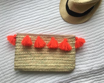 Handwoven Date Palm Clutch Bag with Neon Orange Pom-Pom detail