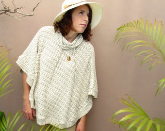 white and gray woven poncho / sweater