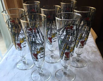 7 Vintage Libby Footed Pilsner Glasses with Gold Rims and a Pirate Scene Motif