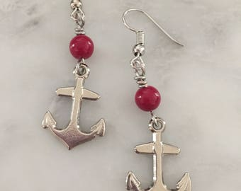 Silver anchor charm earrings with red accent beads
