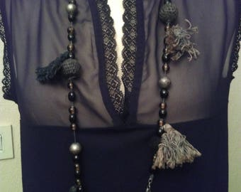 Necklace made of beads and tassels