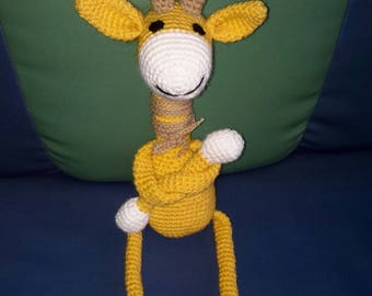 Toy giraffe knitting by hand