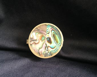 Silver pill box with mother of Pearl.