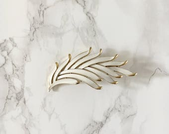 white-enamel leaf brooch