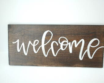 Welcome sign - hand lettered wood panel
