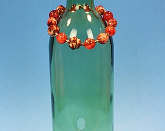 Light green bottle with multi-colored beads