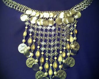 This one of a kind layered necklace is by far my favorite. Layers of chain, beads and charms