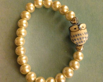 Glass pearl and owl bracelet