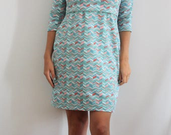 Maternity and nursing dress in pastel green colours. Cool maternity and nursing dress, beautiful maternity clothes
