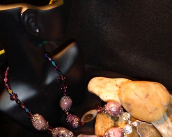 Crystal Pendant Supported by Purple Glass Beads & Purple Stones