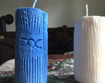 Wood grain style candles with small carving