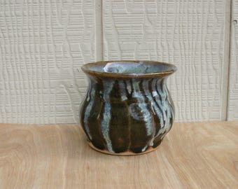 Green Ceramic Vase With A Blue Drippy Rim