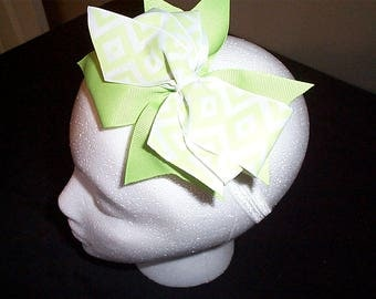 Lime Green and White print Bow on a white headband
