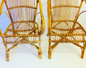 A pair of Vintage Cane and bamboo chairs