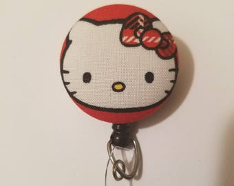 Hello Kitty magnet, pin, or badge reel