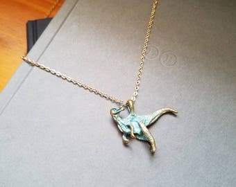 Blue Tinted Gold T-Rex Necklace